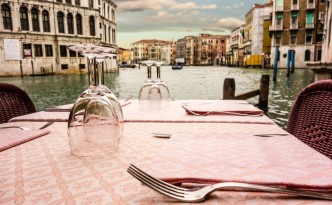 28998787 - a romantic table set on the waterside in venice, italy